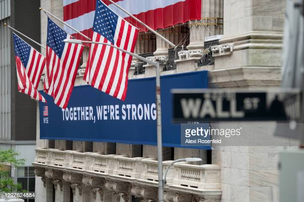 """View of the """"Together, We're Strong"""" banner in front of the New York Stock Exchange on May 28, 2020 in New York City. The NYSE partially reopened its..."""