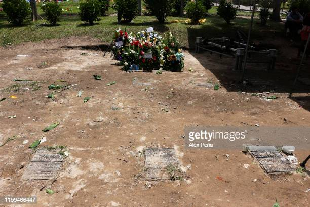 A view of the tomb and floral arrangements after the funeral of Óscar Alberto Martínez Ramírez and his daughter Valeria at San Romero memorial park...
