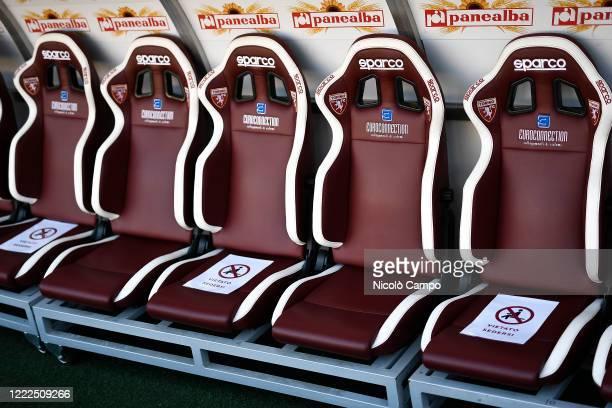 View of the Torino FC bench with signs of seats not available for sitting to keep safe distances prior to the Serie A football match between Torino...