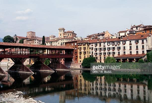 View of the town and Ponte Vecchio or Ponte degli Alpini over the Brenta river, designed by Andrea Palladio in 1569, Bassano del Grappa, Veneto,...
