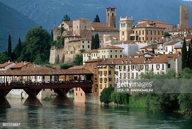 View of the town and Ponte Vecchio or Ponte degli Alpini over the Brenta river designed by Andrea Palladio in 1569 Bassano del Grappa Veneto Italy