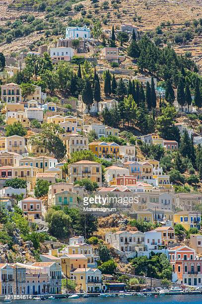 view of the town - symi stock photos and pictures