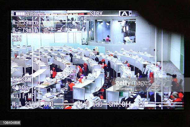 A view of the trading floor at the Hong Kong stock exchange is seen on a video camera's LCD panel in Hong Kong China on Thursday Oct 29 2010 AIA...