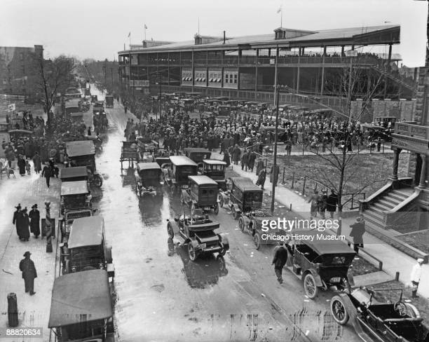 View of the traffic surrounding Wrigley Field, home of the National League's Chicago Cubs, as fans gather for a game, ca.1920s. Vehicles can be seen...
