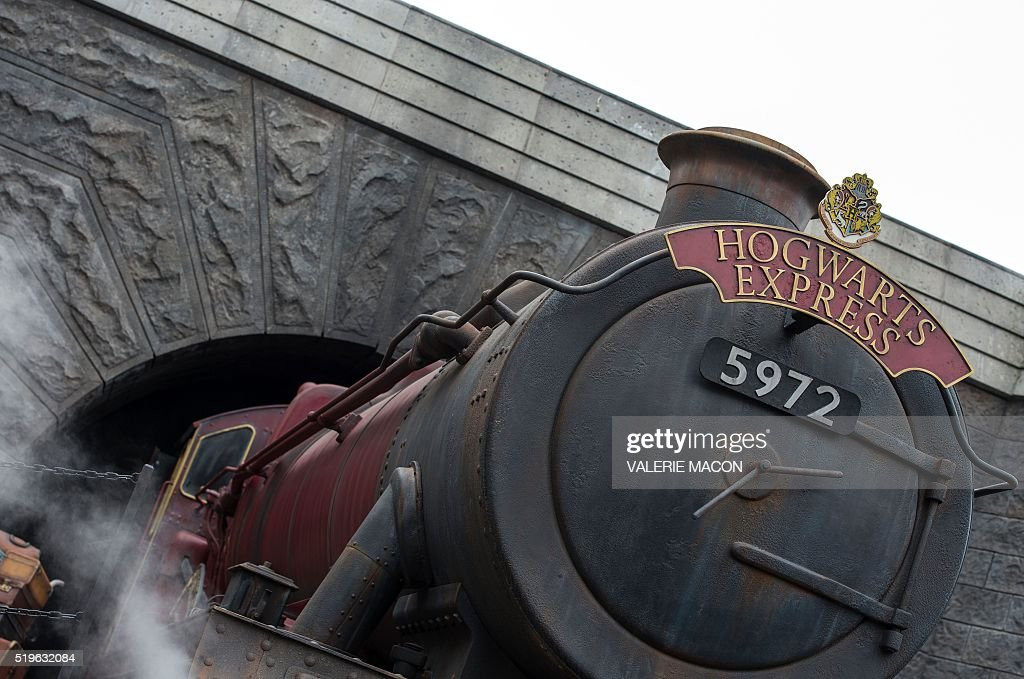 View of the train in Hogsmeade at the Grand Opening of the 'Wizarding World of Harry Potter' at Universal Studios Hollywood, in Universal City, California, on April 7, 2016. Fifteen years after Harry Potter's first big screen adventure, Universal is enchanting a new generation of Muggles with its most spectacular conjuring trick yet -- a theme park in the heart of Hollywood. / AFP / VALERIE