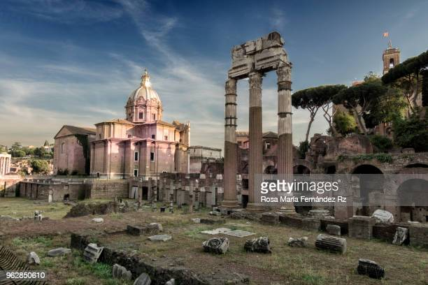 view of the trajan's forum and santi luca e martina church in, with rome behind at sunset rome, italy - advertising column stock-fotos und bilder