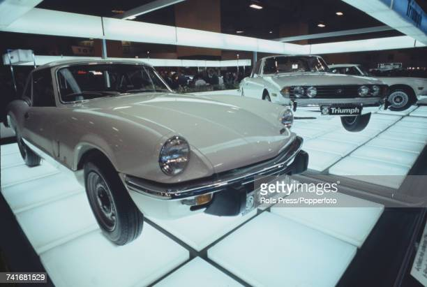 View of the Triumph Cars stand owned by British Leyland Motor Corporation at the annual British International Motor Show featuring new Triumph...