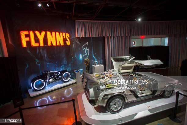 A view of the Tron Lightcycle and the Back to the Future Time Machine during the opening of the new exhibit Hollywood Dream Machines Vehicles Of...