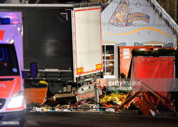 TOPSHOT CORRECTION View of the truck that crashed into a christmas market at Gedächtniskirche church in Berlin on December 19 2016 killing at least...