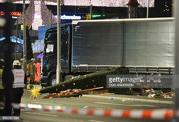 TOPSHOT View of the truck that crashed into a christmas market at Gedächtniskirche church in Berlin on December 19 2016 killing at least nine people...