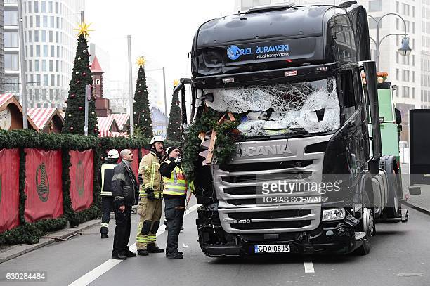 TOPSHOT View of the truck that crashed the evening before into a christmas market at Gedächtniskirche church on early December 20 2016 in Berlin...