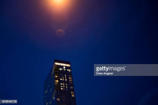 A view of the Trump SoHo hotel condominium building at dusk February 21 2017 in New York City The development of Trump SoHo completed in 2010 was...