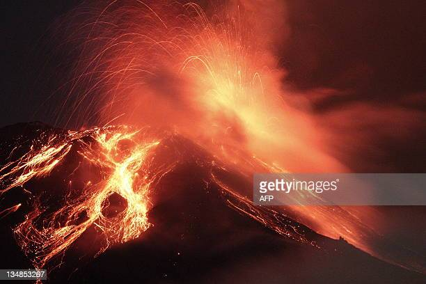 View of the Tungurahua Volcano throwing incandescent rocks and lava, from the town of Runtun, Ecuador, on December 4 135 km south of Quito. A...