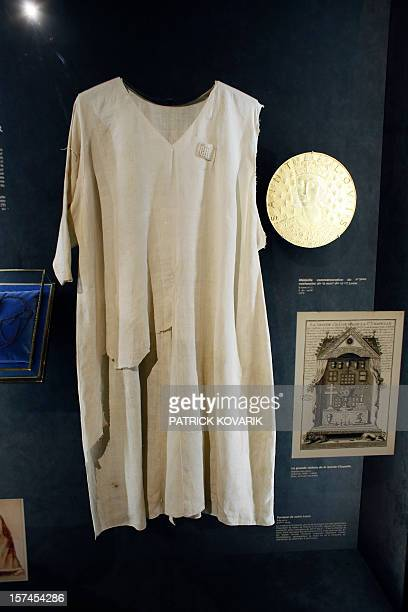 A view of the tunic allegedly worn by Saint Louis on display inside the NotreDame de Paris cathedral in Paris on November 29 2012 AFP PHOTO / PATRICK...