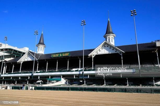 View of the twin spires and empty grandstand at Churchill Downs on May 02, 2020 in Louisville, Kentucky. The 146th running of the Kentucky Derby,...