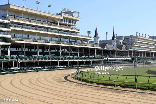 View of the twin spires and empty grandstand from the first turn at Churchill Downs on May 02, 2020 in Louisville, Kentucky. The 146th running of the...