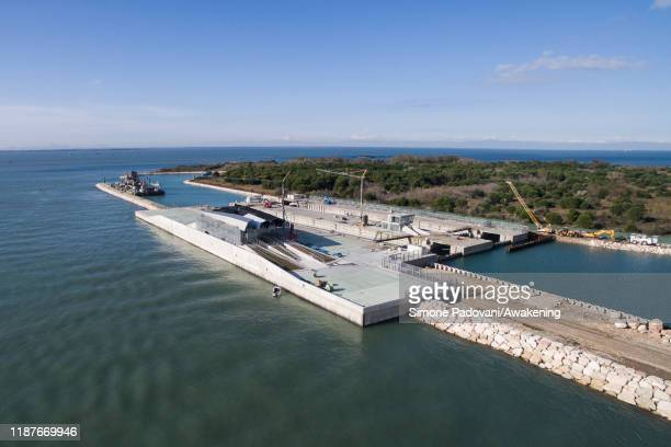 A view of the uncompleted Mose the discussed system to prevent and control the high tide in the Venetian Lagoon is seen on November 14 2019 in Venice...