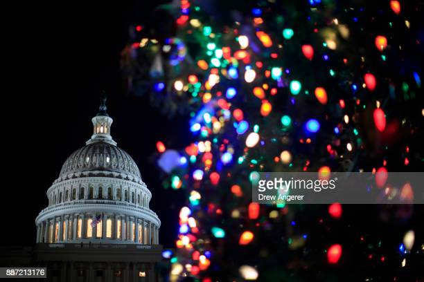 View of the U.S. Capitol during the U.S. Capitol Christmas Tree lighting ceremony on Capitol Hill, December 6, 2017 in Washington, DC. The tree is a...