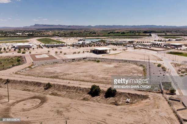 TOPSHOT A view of the US Customs and Border Protection complex housing underage people caught illegally entering the United States at the Tornillo...