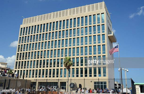 View of the US Embassy building with the US flag raised over it in Havana on August 14 during US Secretary of State John Kerry's visit. The Marine...