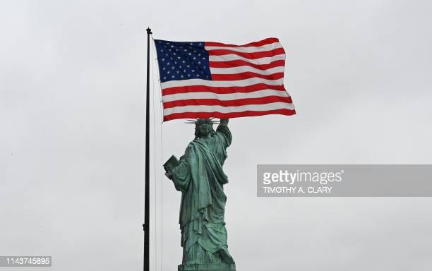 A view of the US flag and the Statue of Liberty from the roof of the museum during a press preview at the new Statue of Liberty Museum on May 13 2019...