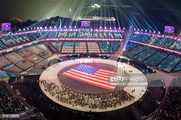 View of the US flag during the opening ceremony of the Pyeongchang 2018 Winter Olympic Games at the Pyeongchang Stadium on February 9 2018 / AFP...