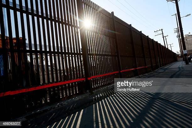 View of the US Mexico border wall on November 19 2014 in Calexico California US President Barack Obama plans to announce executive action on...