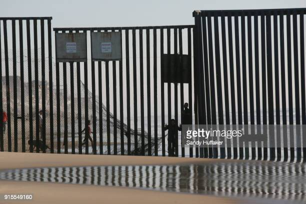 View of the USMexico border during a rally in support of passage of the Dream Act February 7 2018 in San Ysidro California The rally coincides with...