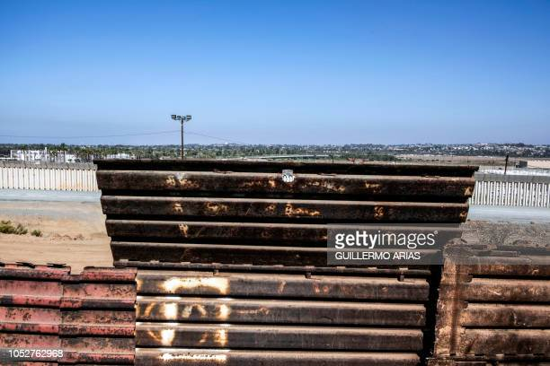 View of the USMexico border fence as seen from Tijuana Baja California state Mexico on October 22 2018 US President Donald Trump on Monday called the...
