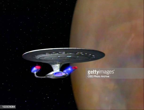 View of the USS Enterprise in flight in a scene from an episode of the television series 'Star Trek The Next Generation' entitled 'Interface'...