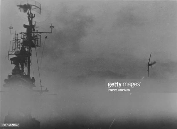 View of the USS Sangamon as it fires tracers towards a Japanese kamikaze airplane, near off Kerama Retto in the Okinawa Islands, May 4, 1945.