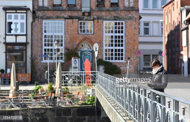 View of the usually very full area of Am Sande on Mon March 25, 2020 in Luneburg, Germany. Everyday life in Germany has become fundamentally altered...