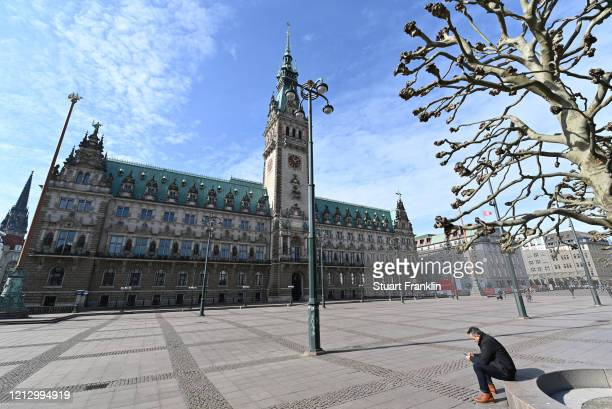 A view of the very nearly empty Rathaus place after the Senate of Hamburg has released a decree to limit social life heavily on March 17 2020 in...