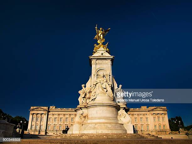 CONTENT] A view of the Victoria Memorial a stunning statue outside the palace and the palace in the background Buckingham Palace is the London...