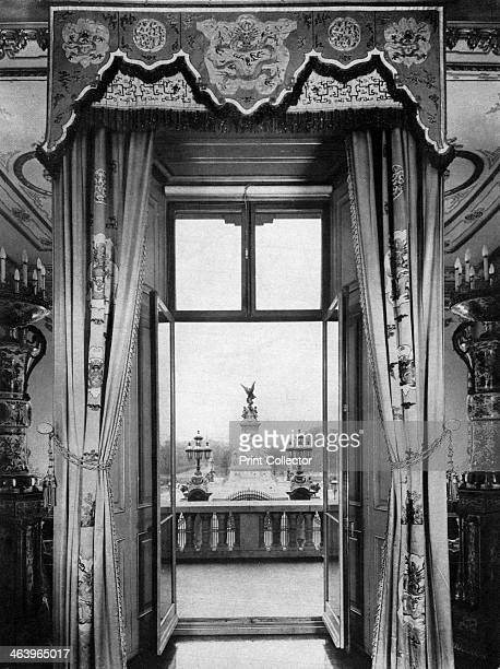 View of the Victoria Monument from inside Buckingham Palace London 1935 The Victoria Monument stands at the end of the Mall in front of Buckingham...