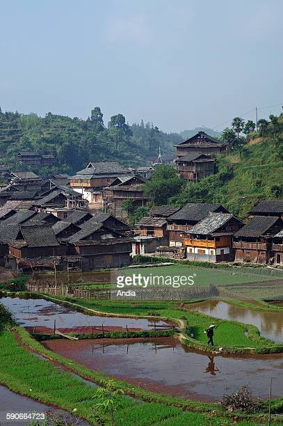 View of the village of Xaohuang, Dong village in the province of Guizhou, People's Republic of China, 2007. Landscape with the village hemmed in by...