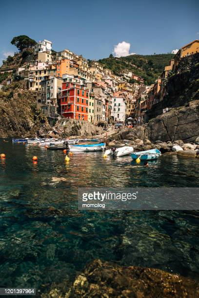 view of the village riomaggiore in italy - fishing village stock pictures, royalty-free photos & images