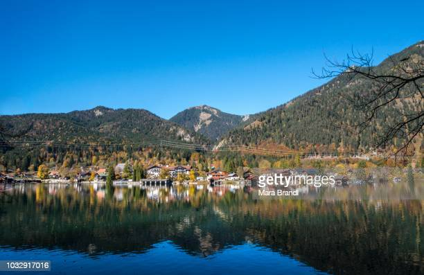 View of the village Walchensee in autumn, water reflection, lake Walchensee, Upper Bavaria, Bavaria, Germany