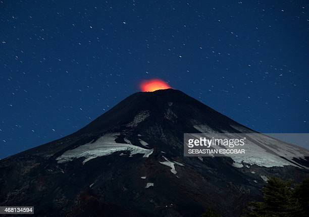 View of the Villarrica volcano from Pucon some 800 km south of Santiago showing visible signs of activity on March 30 2015 Earlier this month in its...