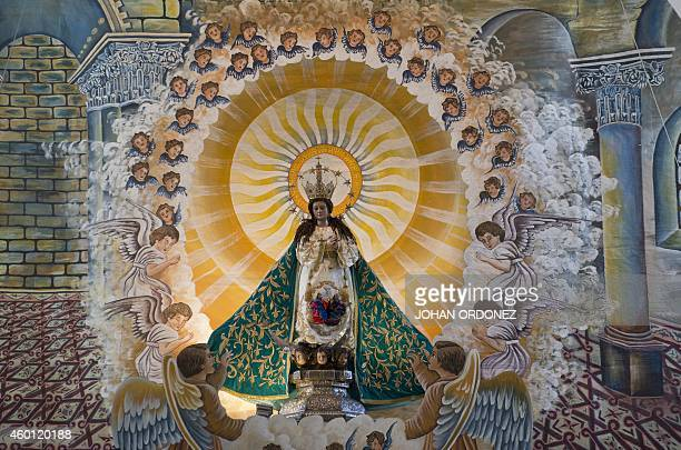 View of the Virgin of the Immaculate Conception image during celebrations on December 7 2014 in Sacatepequez some 60 km southeast of Guatemala City...