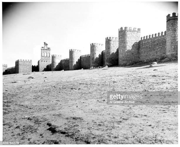View of the walls surrounding Avila, Spain. Circa 1900.