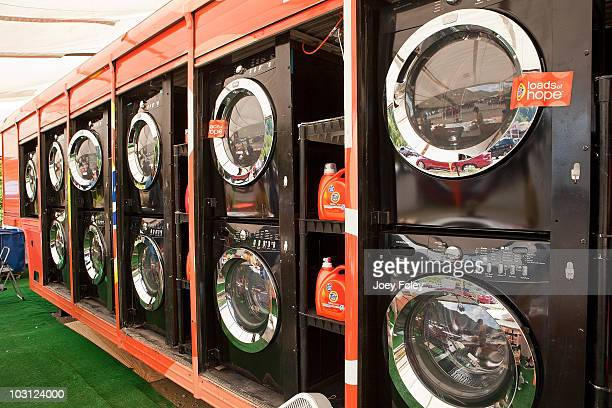 A view of the washers and dryers inside The Tide's Loads Of Hope mobile laundry truck at Tide's Loads Of Hope mobile laundry program at the Loads of...