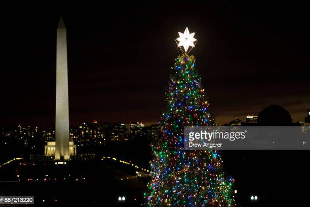A view of the Washington Monument and Capitol Christmas tree after the US Capitol Christmas Tree lighting ceremony on Capitol Hill December 6 2017 in...