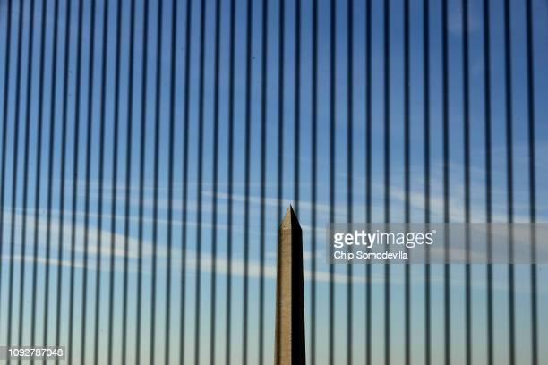 A view of the Washington Monument seen between wires that cover the windows on the observation deck of the Old Post Office Tower January 11 2019 in...