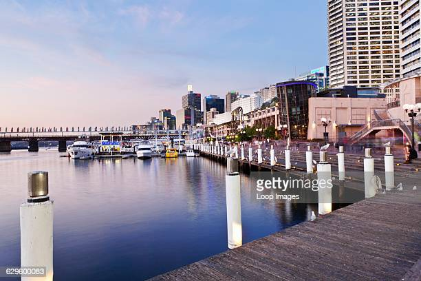A view of the waterfront at Darling Harbour at dusk Sydney Australia