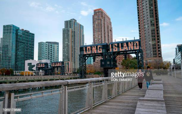 A view of the waterfront of Long Island City in the Queens borough of New York along the East River on November 7 2018 Amazon is planning to split...