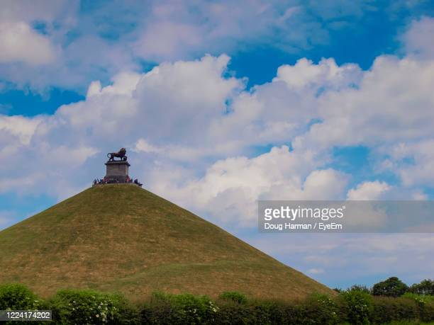 a view of the waterloo battlefield belgium against sky with butte du lion in the foreground. - waterloo belgium stock pictures, royalty-free photos & images