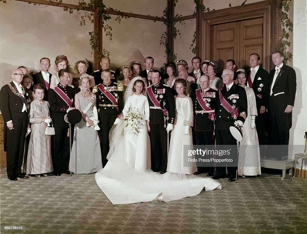 View of the wedding party of Crown Prince Harald of Norway pictured with his wife Sonja Haraldsen (later Queen Sonja of Norway), family members and guests following the wedding ceremony in Oslo, Norway on 29th August 1968. Prince Harald would later become Harald V of Norway. King Olav V of Norway can be seen on right of royal couple standing next to King Gustaf VI Adolf of Sweden.
