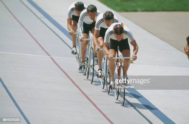 View of the West Germany cycling team competing to finish in bronze medal position in the Men's team pursuit cycling event at the 1984 Summer...