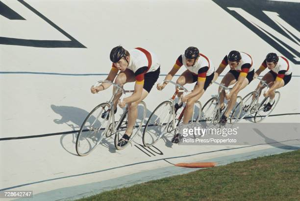 View of the West Germany men's team pursuit team of Gunter Haritz Peter Vonhof Hans Lutz and Gunther Schumacher pictured in action together during...